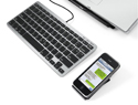 Slim One Keyboard shown with laptop and iPhone