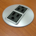 Optional Grommet-Mounted Power Outlets in Silver or Black